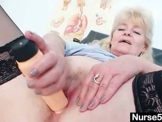 Aged blond lady shows off natural tits and dildo s