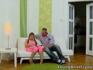 Anna sits quietly в її сексуальна рожевий outfit і looks сексуальна waiting для її людина