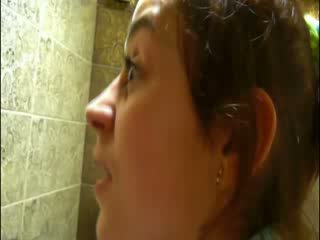Pissing on disco toilet before camera