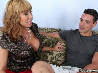 Busty mom giving head to her son's fri...