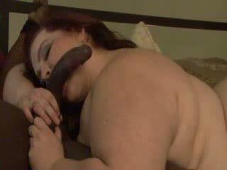 BBW sucking a massive black cock Video