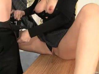 Milf boss Alana Evans sucking cock in her office