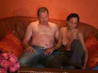 Pāris having sekss uz the livingroom