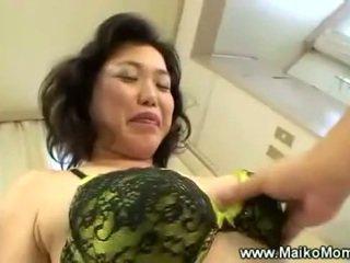 Rubbing mature maikos hairy pussy