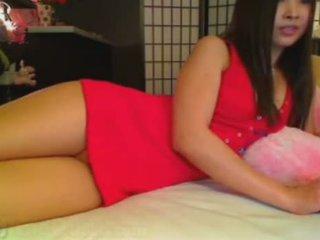 Mignonne asiatique projection son cul sur webcam