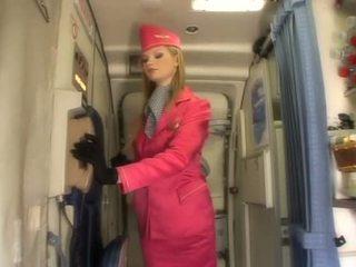 Nice blonde stewardess sucking cock onboard