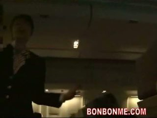 Mosaic; stewardess gives passenger groot pijpen