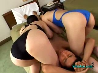 2 Asian Girls In Swimsuits Sucking cock